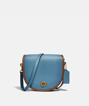 TURNLOCK SADDLE CROSSBODY IN COLORBLOCK