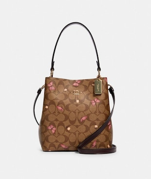SMALL TOWN BUCKET BAG IN SIGNATURE CANVAS WITH BUTTERFLY PRINT
