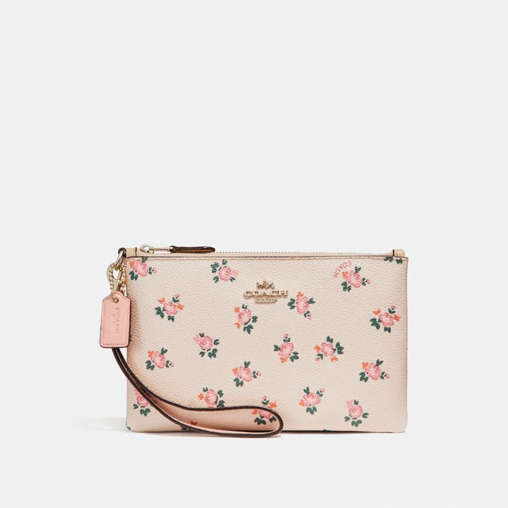 SMALL WRISTLET WITH FLORAL BLOOM PRINT