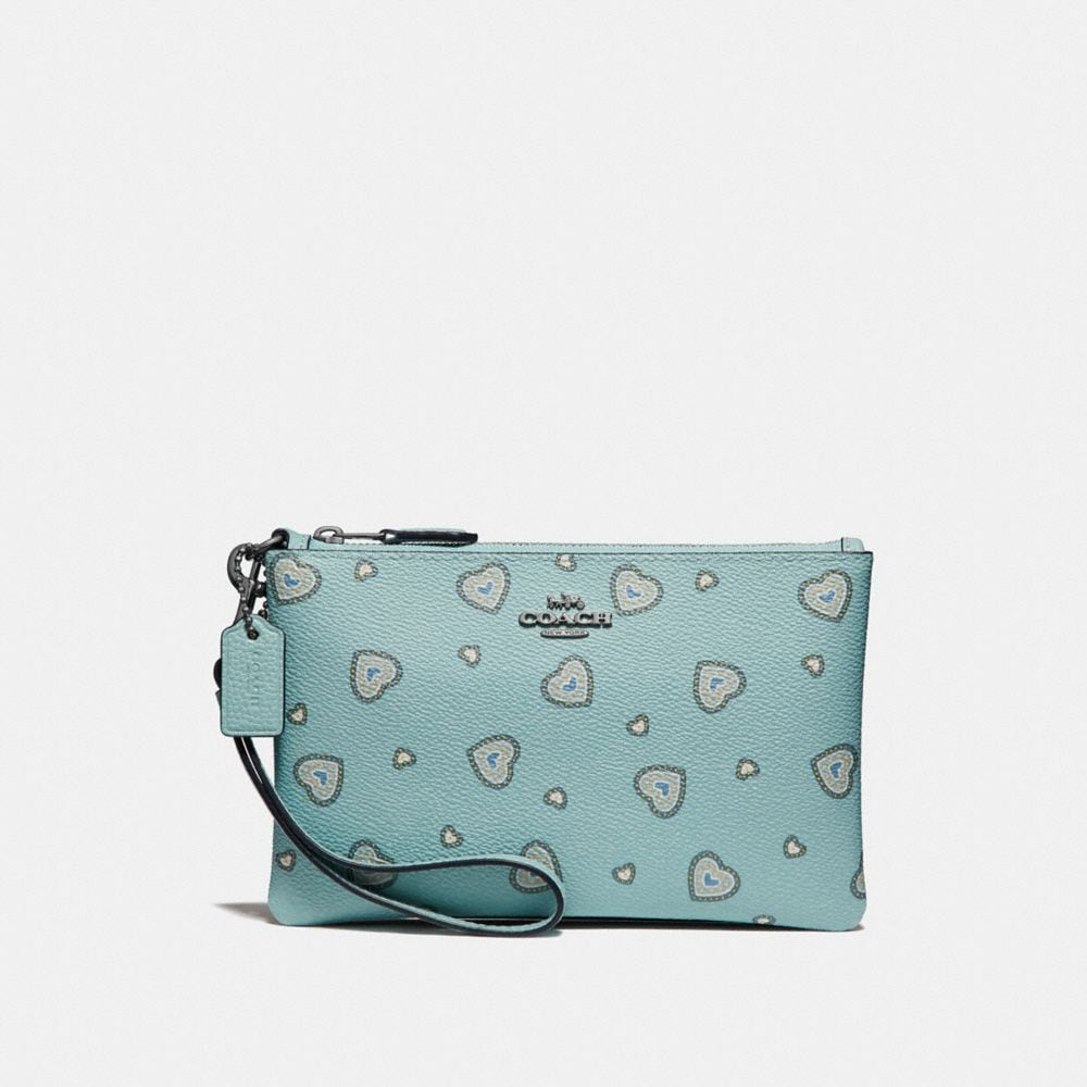 SMALL WRISTLET WITH WESTERN HEART PRINT