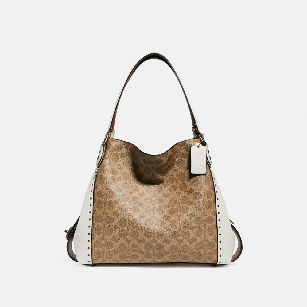 EDIE SHOULDER BAG 31 IN SIGNATURE CANVAS WITH BORDER RIVETS