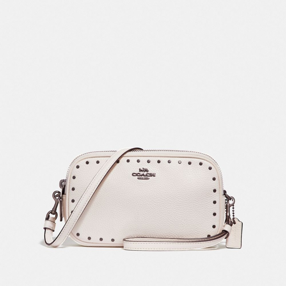 CROSSBODY CLUTCH WITH BORDER RIVETS