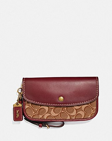 CLUTCH IN SIGNATURE JACQUARD