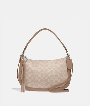 SUTTON CROSSBODY IN SIGNATURE CANVAS