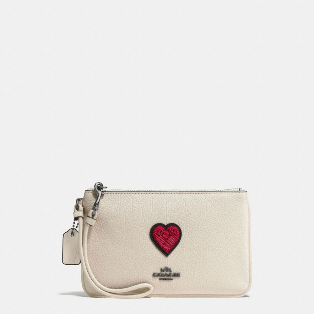 SMALL WRISTLET IN GRAIN LEATHER WITH SOUVENIR EMBROIDERY