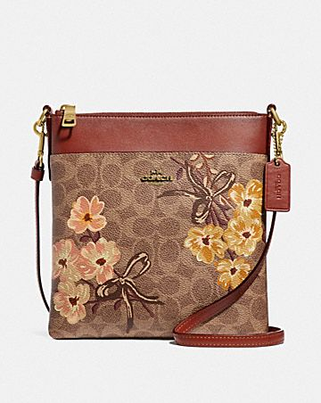 3cbfce12fea3 KITT MESSENGER IN SIGNATURE CANVAS WITH PRAIRIE FLORAL PRINT