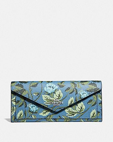 SOFT WALLET WITH SLEEPING ROSE PRINT