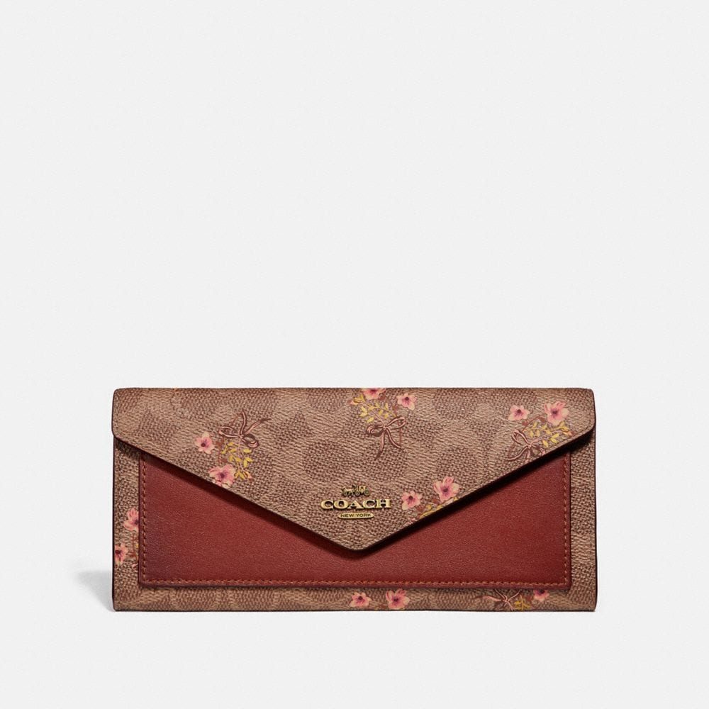 SOFT WALLET IN SIGNATURE CANVAS WITH FLORAL PRINT