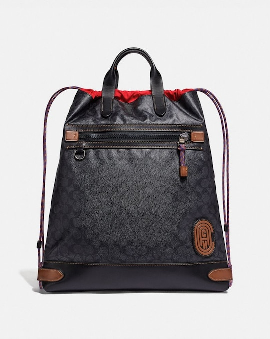 ACADEMY DRAWSTRING BACKPACK IN SIGNATURE CANVAS WITH COACH PATCH