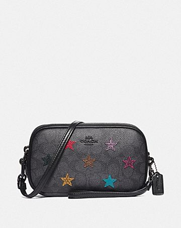 SADIE CROSSBODY CLUTCH IN SIGNATURE CANVAS WITH STAR APPLIQUE AND SNAKESKIN DETAIL