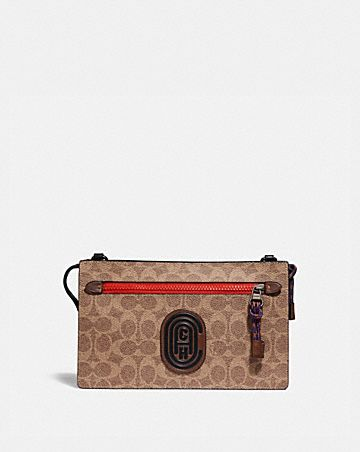 RIVINGTON CONVERTIBLE POUCH WITH SIGNATURE CANVAS BLOCKING AND COACH PATCH