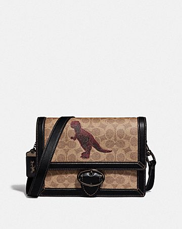RILEY CROSSBODY 24 IN SIGNATURE CANVAS WITH REXY BY SUI JIANGUO