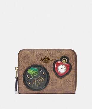 WIZARD OF OZ BOXED SMALL ZIP AROUND WALLET IN SIGNATURE CANVAS WITH PATCHES