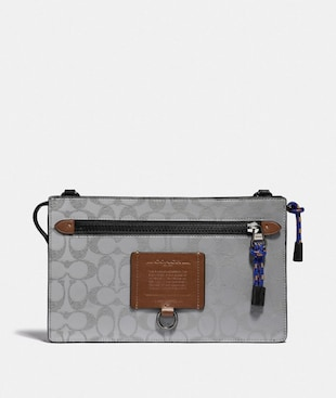 RIVINGTON CONVERTIBLE POUCH IN REFLECTIVE SIGNATURE CANVAS