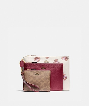 TRIPLE POUCH IN SIGNATURE CANVAS AND FLORAL PRINT