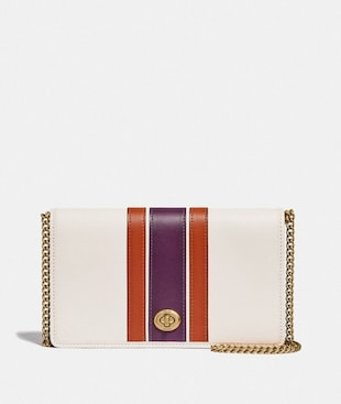 CALLIE FOLDOVER CHAIN CLUTCH WITH VARSITY STRIPE