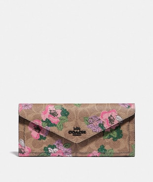 SOFT WALLET IN SIGNATURE CANVAS WITH BLOSSOM PRINT