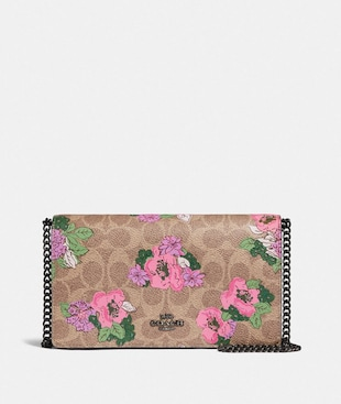 CALLIE FOLDOVER CHAIN CLUTCH IN SIGNATURE CANVAS WITH BLOSSOM PRINT