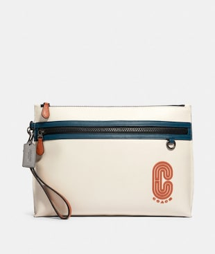 SPORTY CARRY ALL POUCH IN COLORBLOCK WITH COACH PATCH