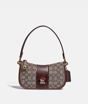 SWINGER BAG IN SIGNATURE JACQUARD WITH APPLE