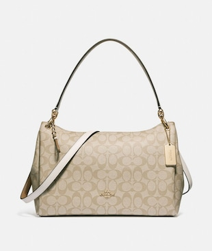 MIA SHOULDER BAG IN SIGNATURE CANVAS