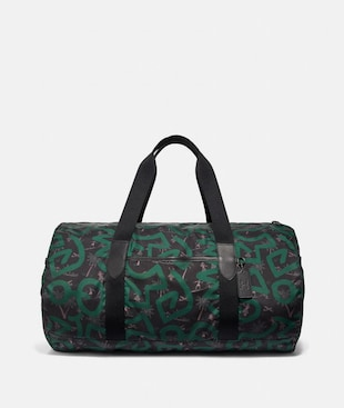 KEITH HARING PACKABLE DUFFLE WITH HULA DANCE PRINT
