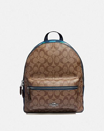 MEDIUM CHARLIE BACKPACK IN SIGNATURE CANVAS WITH RAINBOW COACH ANIMATION