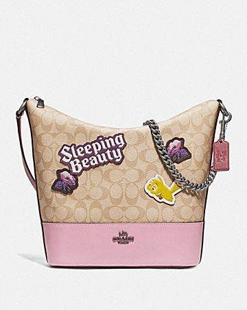 DISNEY X COACH PAXTON DUFFLE IN SIGNATURE CANVAS WITH SLEEPING BEAUTY