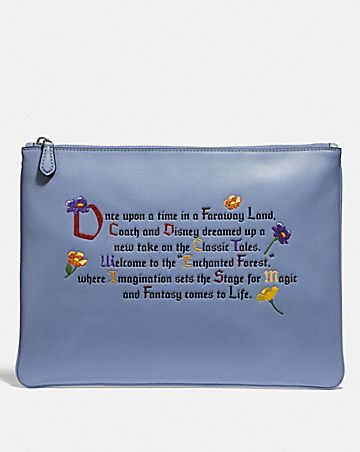 DISNEY X COACH LARGE WRISTLET 30 WITH ENCHANTED FOREST ONCE UPON A TIME PRINT