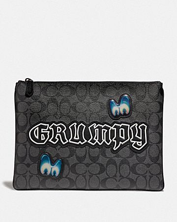 DISNEY X COACH LARGE POUCH IN SIGNATURE CANVAS WITH GRUMPY