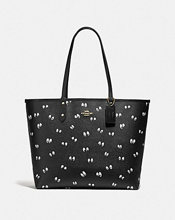 DISNEY X COACH REVERSIBLE CITY TOTE IN SIGNATURE CANVAS AND SNOW WHITE AND THE SEVEN DWARFS EYES PRINT