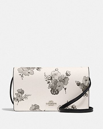 HAYDEN FOLDOVER CROSSBODY CLUTCH WITH FAIRY TALE FLORAL PRINT
