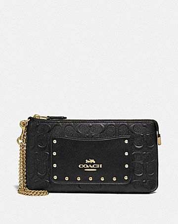 LARGE WRISTLET IN SIGNATURE LEATHER