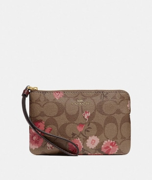 CORNER ZIP WRISTLET IN SIGNATURE CANVAS WITH PRAIRIE DAISY CLUSTER PRINT