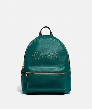 MEDIUM CHARLIE BACKPACK WITH STUDDED COACH SCRIPT