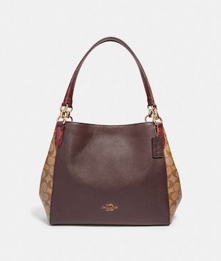 HALLIE SHOULDER BAG IN SIGNATURE CANVAS