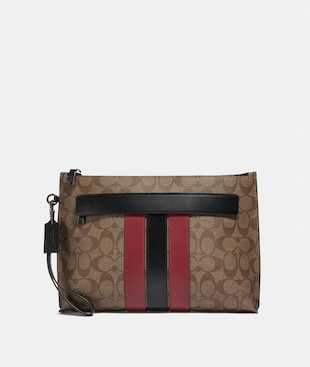CARRYALL POUCH IN SIGNATURE CANVAS WITH VARSITY STRIPE