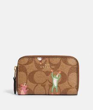 ZIP AROUND COIN CASE IN SIGNATURE CANVAS WITH PARTY ANIMALS PRINT